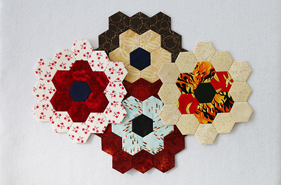 Straight View of Four Hand Sewn English Paper Piecing Hexagon Flowers