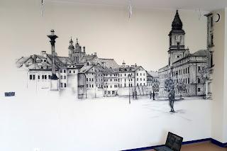 Malowanie obrazu na ścianie, mural przedstawia Warszawską Starówkę, obraz malowany na scianie farbami akrylowymi