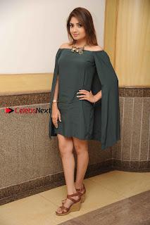 Kannada Actress Karunya Ram Stills in Strapless Green Short Dress at Eradu Kanasu Movie Press Meet  0012.jpg