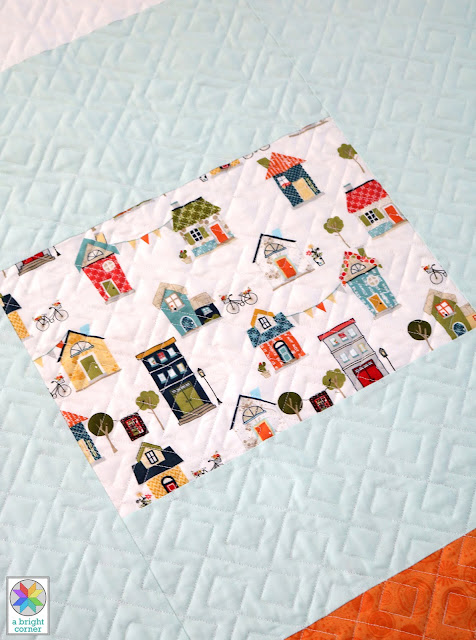 Pieced quilt back by Andy of A Bright Corner - a fun way to use a favorite print