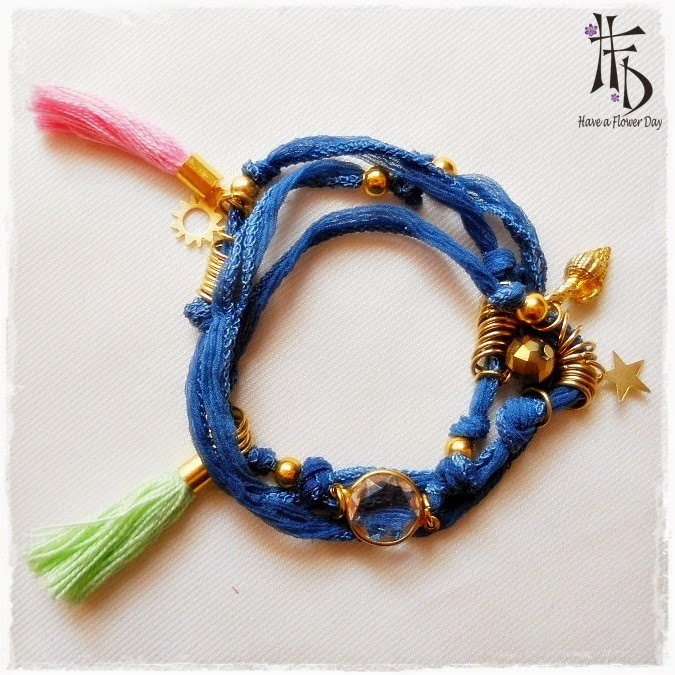 Collar seda india color azul denim con borlas, anillas y charms dorados