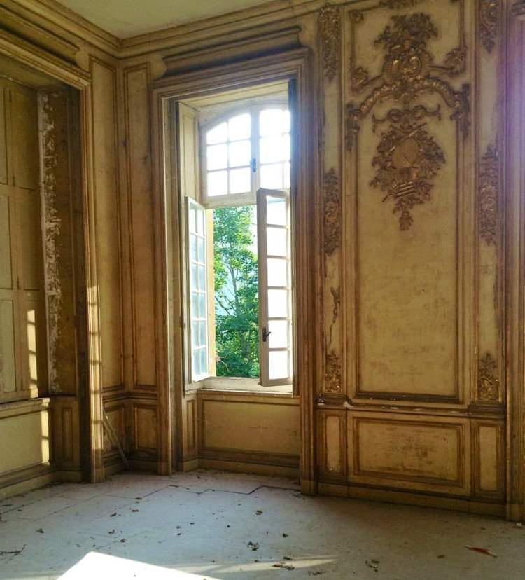 Paneled room and open window in Chateau Gudanes