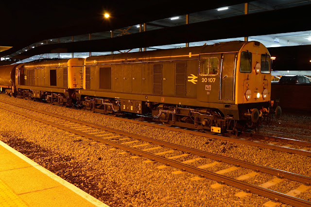 Night photo of Class 20107 and 20096 diesel locomotives in British Rail livery heading a London Underground rolling stock train at Banbury 2017