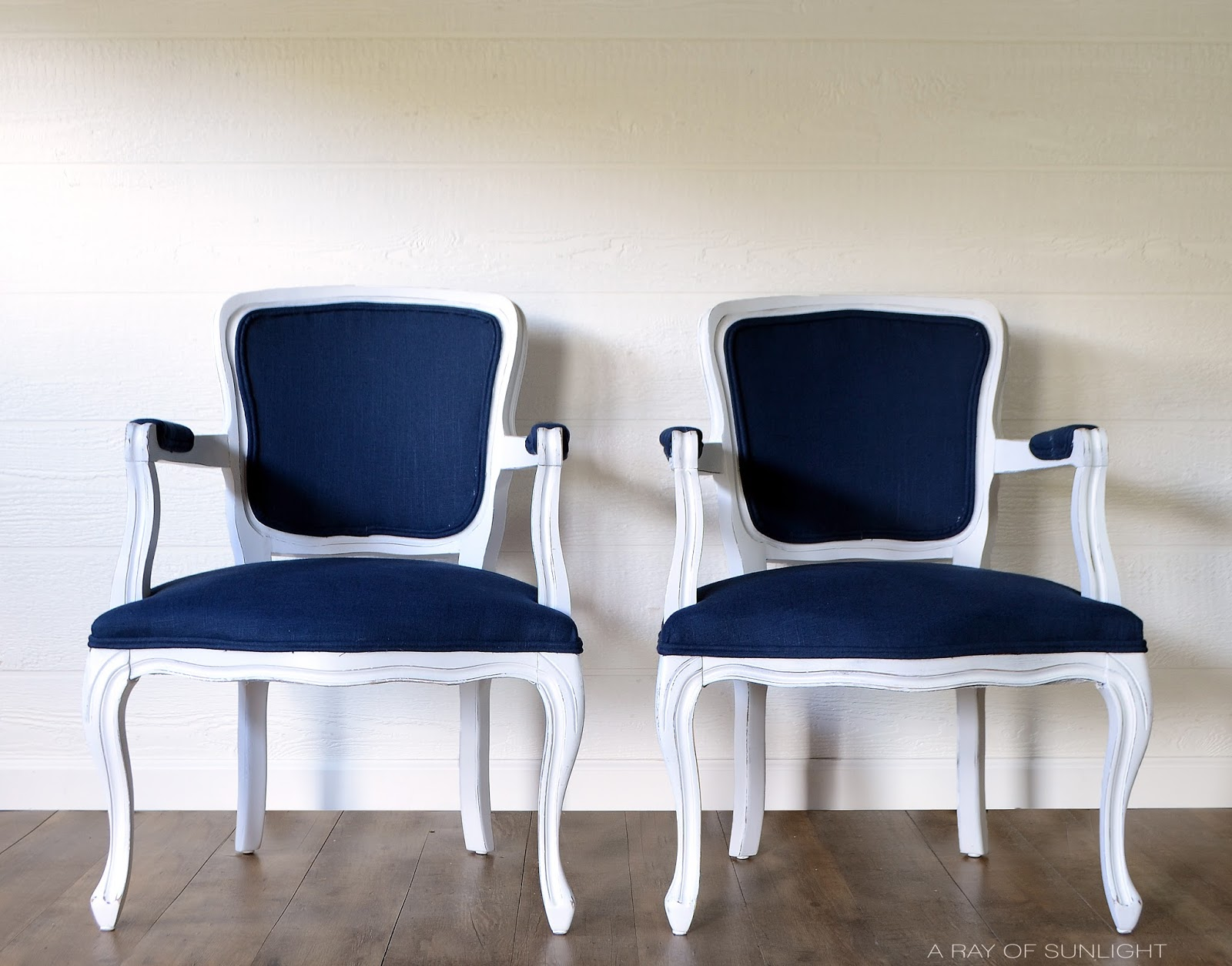 How to easily update old worn out thrift store chairs with some paint and fabric by A Ray of Sunlight Furniture. Love the navy blue and white makeover!