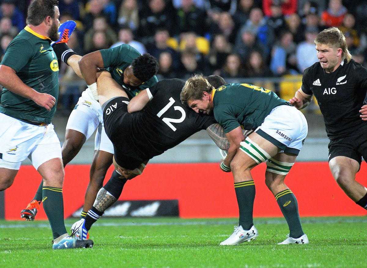 NZ's Sonny Bill Williams is tackled during the Rugby Championship rugby union match between the New Zealand All Blacks and South Africa Springboks at Westpac Stadium in Wellington,