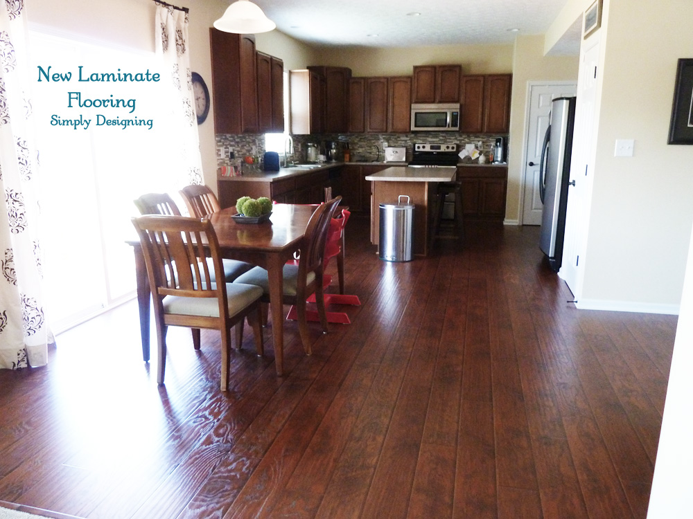 Installing Laminate Flooring   Finishing Trim and Choosing     laying and installing laminate floors tutorial photo of finished kitchen  with laminate wood floors