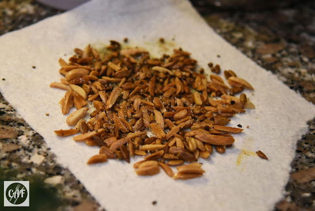 Fried slivered almonds, sunflower seeds and coriander seeds for a grain bowl