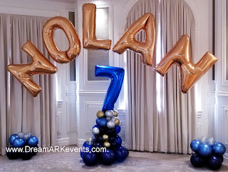 Gold balloon letter arch and balloon number column