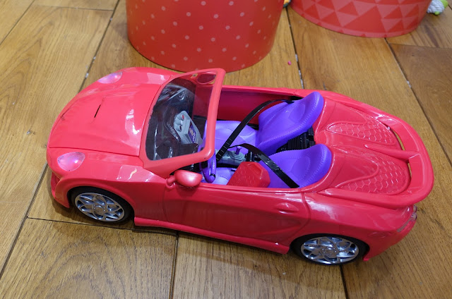 A pinky red remote control car the MC2 dolls can sit in