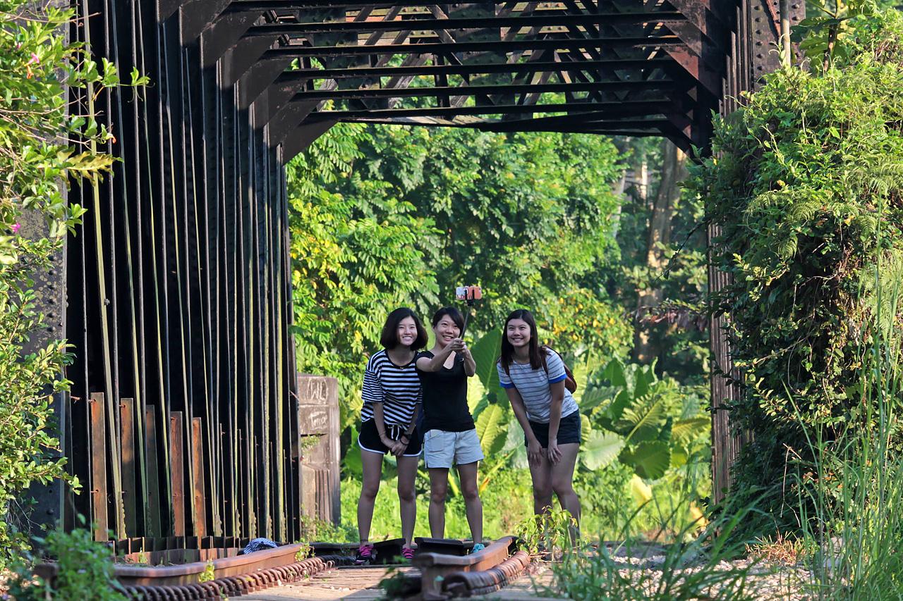 The black railway truss bridge