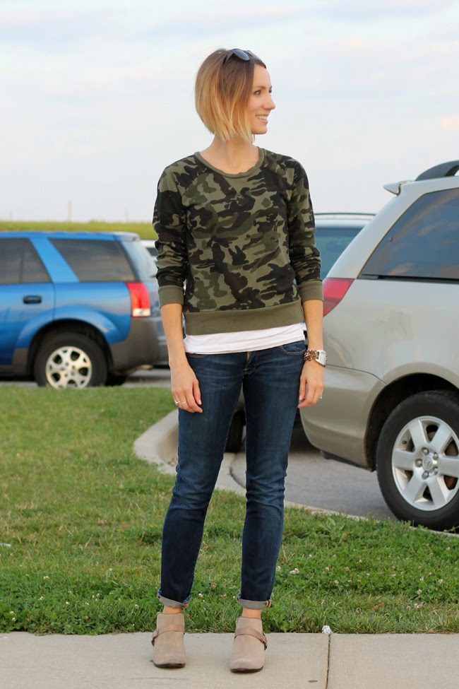 Camo sweatshirt, dark denim and ankle boots