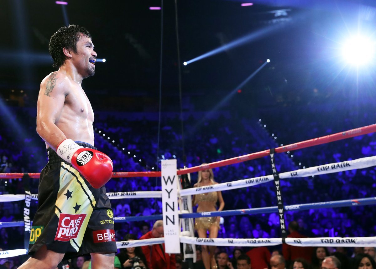 Manny Pacquiao is all smiles after winning the WBO Welterweight title