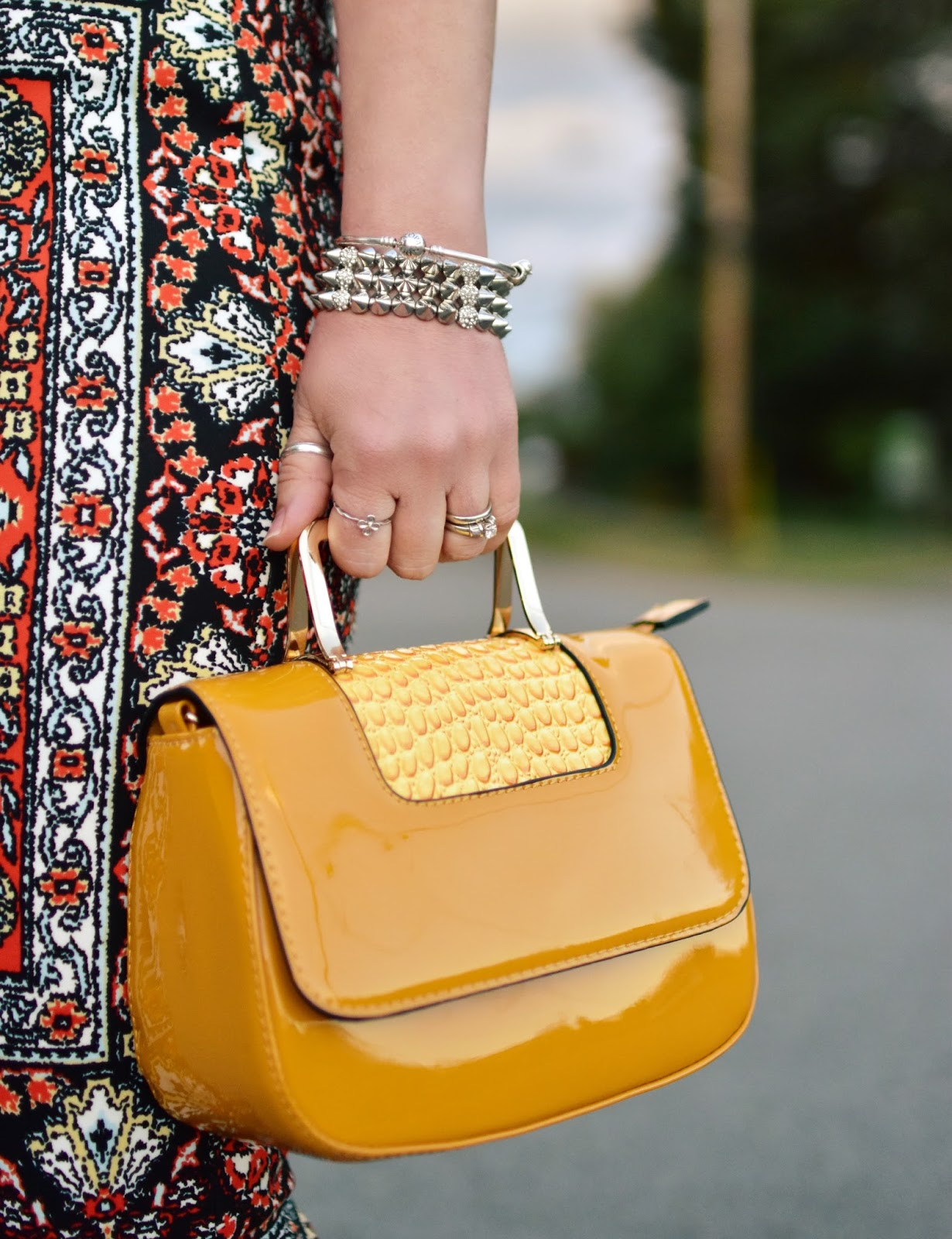 patterned pencil skirt, yellow patent mini bag