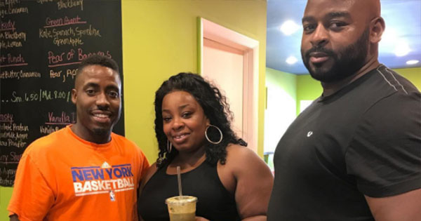 Kenny Minor, owner of Xtract Juice Bar with customers