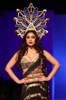 Shriya Sharan walks the Ramp at Amazon Indian Fashion Week with a crown Spicy Saree Choli