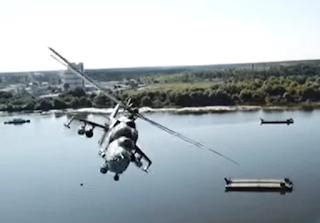 Helikopter Mi-24 Hampir Bertabrakan Dengan Drone