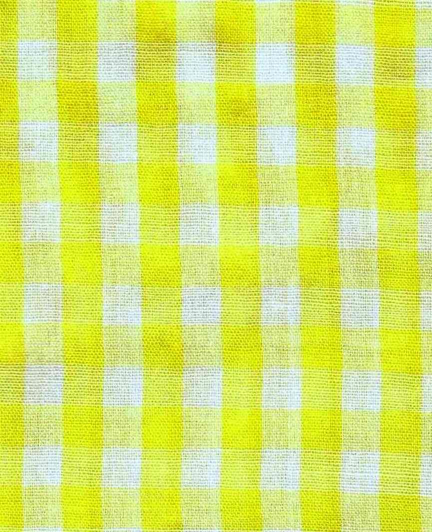 yellow gingham cloth, a color photograph
