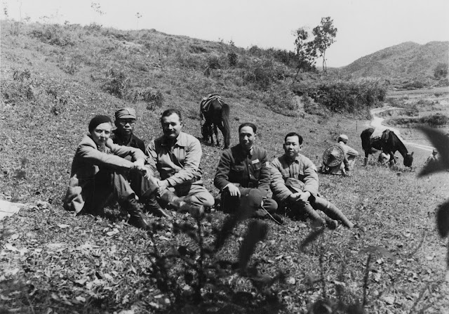 vintage photo of man, woman and several Chinese soldiers in uniform,