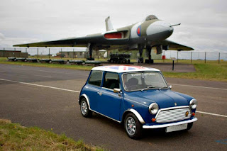 Mini with fighter jet in the background