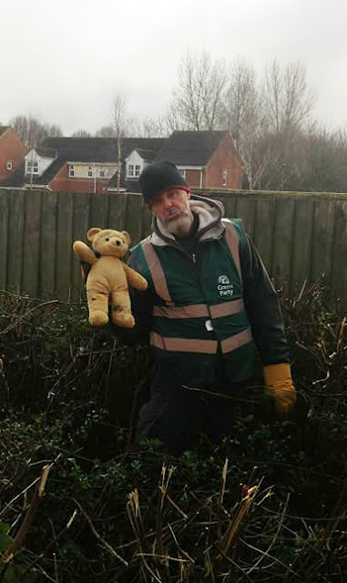 Roger holding a teddy he found in a bush