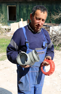 Bekir with some (incorrect) plumbing parts
