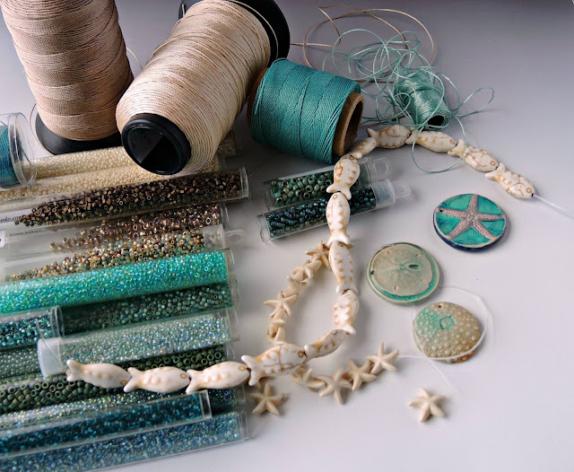 Turquoise, teal and ecru color palette with beads and cord.