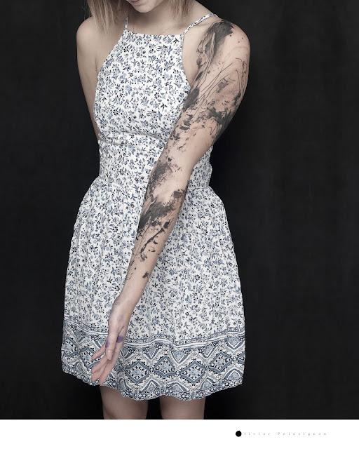 bras tatoue femme aquarelle noire clermont ferrand