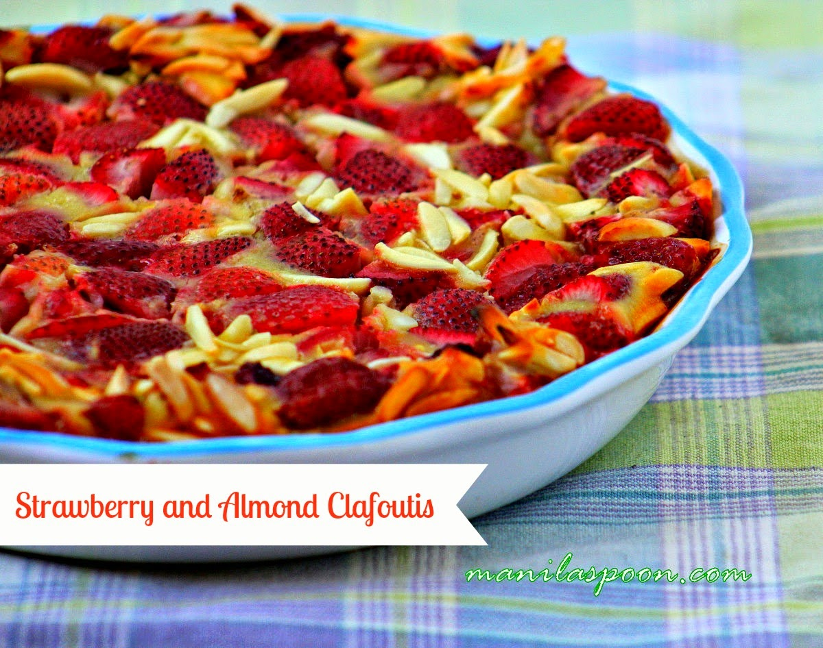 Delectable Strawberry and Almond Clafoutis! It is unbelievably easy to make and yet you're rewarded with so much yumminess!