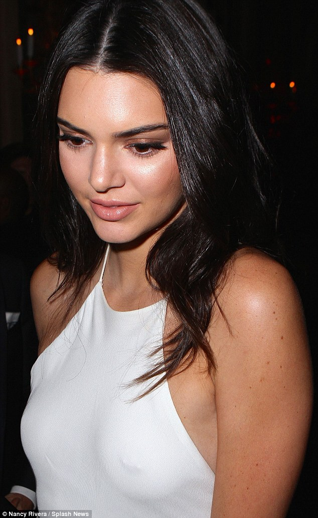 Kendall Jenner flashes nipple piercing under clinging gown at Harper's Bazaar Icons Event
