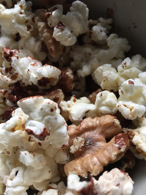 homemade popcorn with walnuts, dark chocolate and a hint of salt