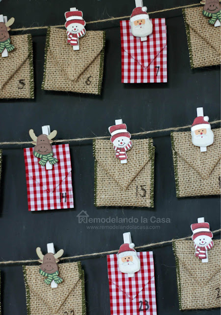 ribbon envelopes hold by Christmas wooden clothpins