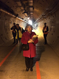 Pic of Karen Andrews standing in service tunnel of the Channel Tunnel
