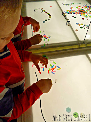 Creating Christmas light patterns on the light table from And Next Comes L