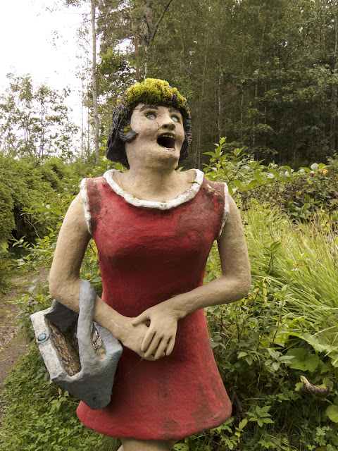 Sculpture of a woman in a red dress at Parikkala Sculpture Park