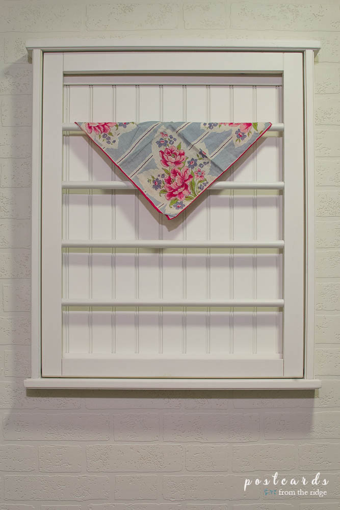 I love this adorable laundry room that she updated for less than $100! I need that drying rack!