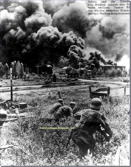 German soldiers approaching burning oil storage tanks ​​Maikop  Krasnodar. October 1942