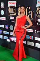 Meenakshi Dixit in Red One Shoulder Red Zipped up gown at IIFA Utsavam Award 13.JPG