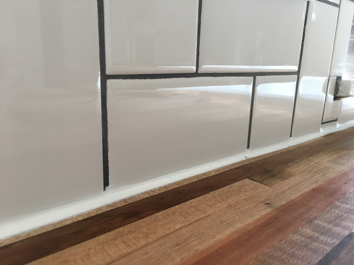 straight herringbone tile backsplash tutorial create enjoy caulk at countertops using a waterproof kitchen bath caulk careful that stuff is super sticky and messy going on use a thin line to start