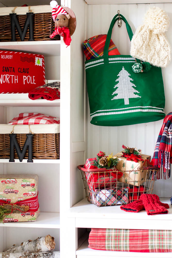 Wire basket with presents and Christmas tree tote bag in DIY mudroom