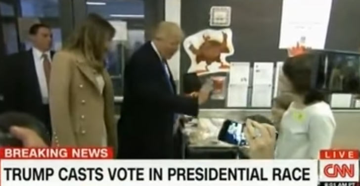 That awkward moment Trump giraffes on another voter while casting his ballot