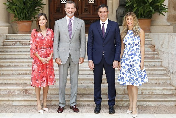 Queen Letizia wore Adolfo Domínguez Floral Print Dress from FW2018 Collection. Maria Begona Gomez Fernandez wore Carolina Herrera dress