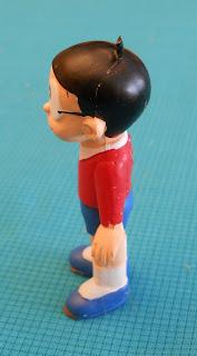 figurita de personaje de manga Nobita