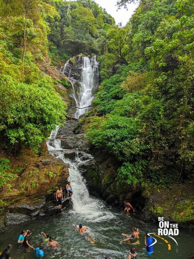 Swimming under the Vibhooti Falls