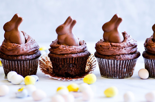 Chocolate cupcakes topped with a whipped chocolate ganache and a miniature chocolate bunny. So cut for Easter!