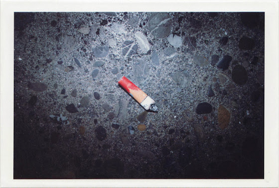 dirty photos - umbra - a night street photo of a cigarette with girl lipstick