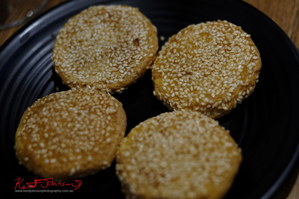 Sesame cakes with red bean and pumpkin filling for desert. Zoo Family restaurant. Food photography by Kent Johnson.
