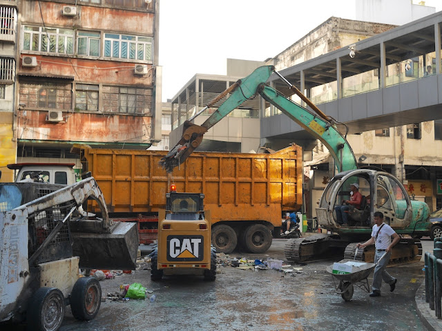 Cleanup from Typhoon Hato using heavy machinery at Rua da Ribeira do Patane