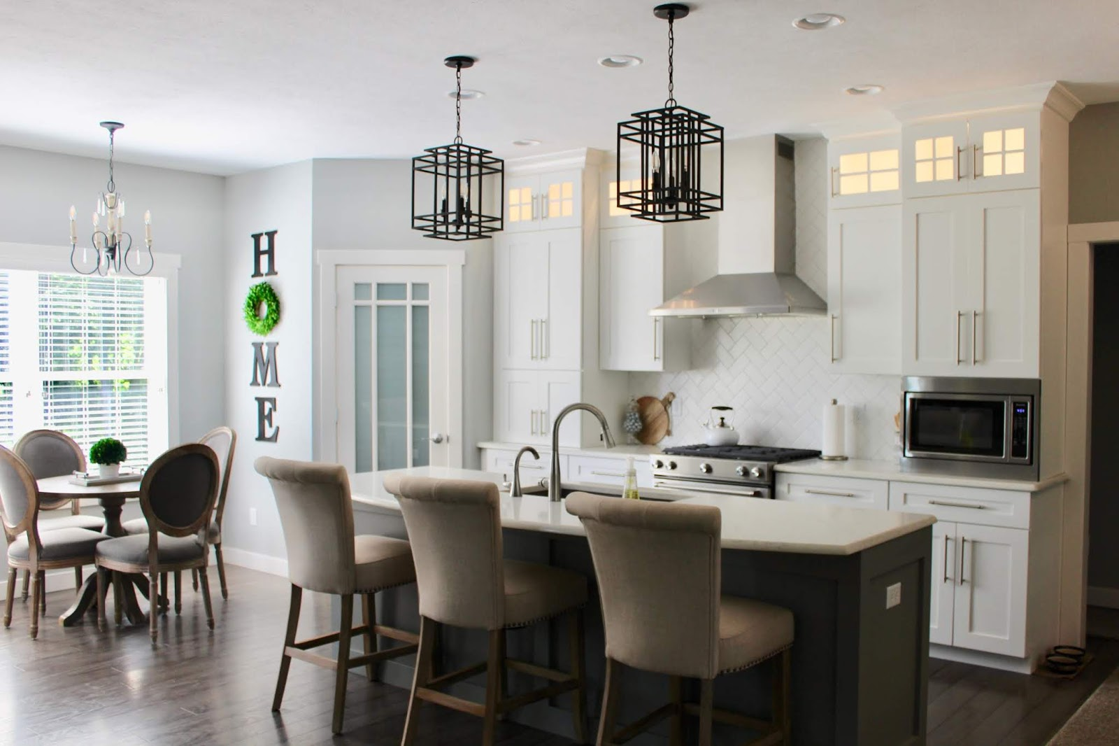 This beautiful open floor plan and gorgeous kitchen is just part of a home tour featuring the home of Andrea at Living on Cloud Nine. Come see this home tour at Poofing the Pillows