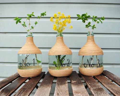 Vasi creativi per fiori e piante idee fai da te e for Porta vino fai da te