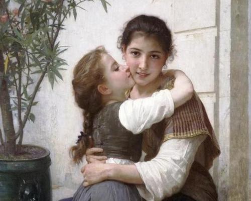Little girl is kissing her older sister